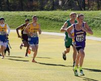 Zac Sutt (R) holds off a pair of St. Vincent runners at 2014 State meet (Photo by Jill Salmon)