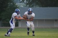 Hollister QB Kyle Sheppard (L) hands off to RB Peter Wittl. (Staff Photo)