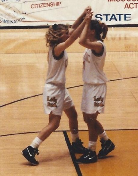 Catholic's Stephanie Thurman (L) and Kristen Baird (R) celebrate the 1992 Class 2A state championship win over Putnam County. (Photo courtesy of Kristen Roubal)