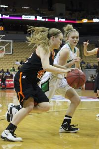 Sarah Kreul drives past a Smithville defender. (Staff Photo)