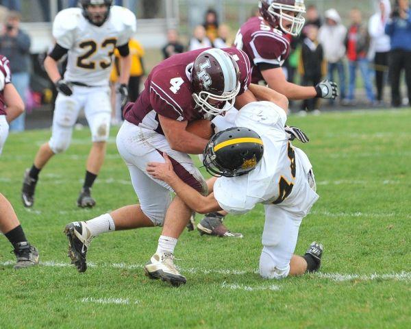 Logan-Rogersville's Joe Zimmer bowls over a Cassville defender. (Photo courtesy of Chuck Nickle Photography)